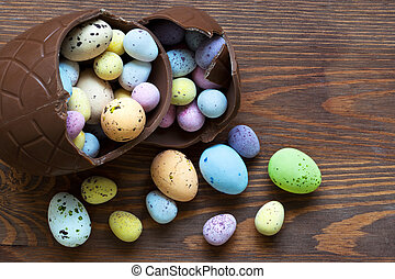 Large chocolate easter egg full of small candy