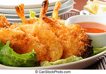 Coconut Shrimp - A plate of coconut shrimp with sauce