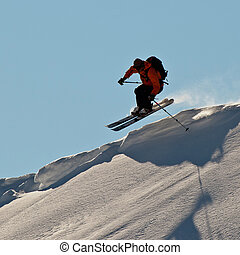 Young man skiing in Caucasus mountains