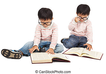 children reading  book on the floor and isolated on white