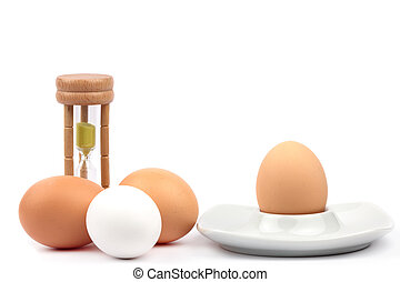 Chicken eggs and egg cups and eggtimer