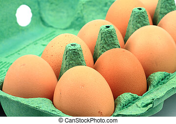 Brown chicken eggs in a carton