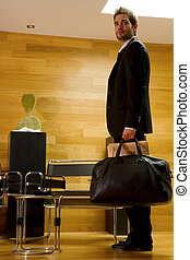 business man waiting in office lobby