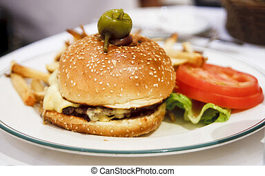 Gourmet Burger with Lettuce and Tomato - A gourmet hamburger...
