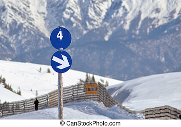 A blue ski slope with number 4 in the Austrian Alps
