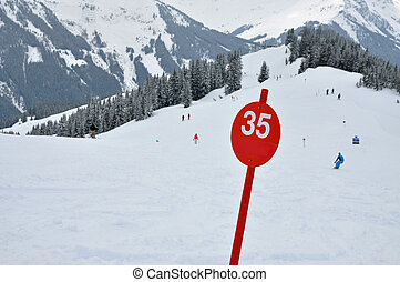 A red ski slope with number 35 in the Austrian Alps