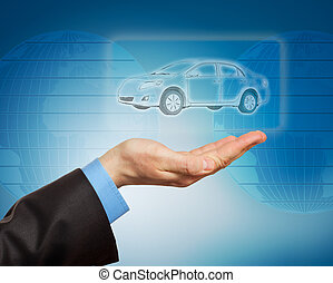Man hand holding car icon on dark