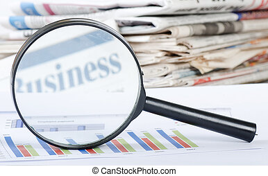 Business diagramme with magnifying glass