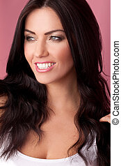 Head shot of a smiling brunette looking to her right on a...