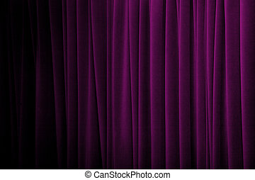 Purple curtains with many folds and dark gradually from the...