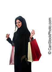 Beautiful arab traditional woman holding shopping bags