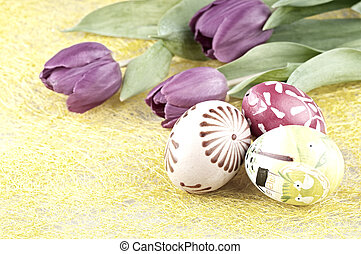 Retro still life - The painted easter eggs and tulip on the...