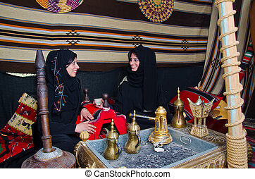 Arab Women sitting in a traditional tent