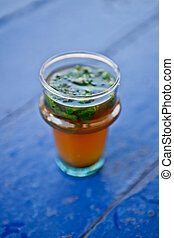Tea in Morocco. - Glass of mint tea on blue table in Rabat,...
