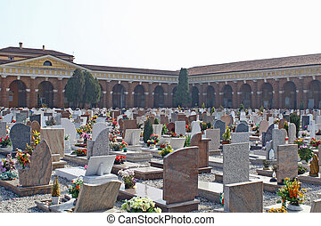 graves  headstones and crucifixes of a cemetery  in Italy