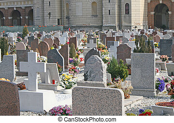 graves  headstones and crucifixes of a cemetery outdoor