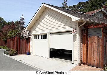 Open Garage - Open garage door in suburban house