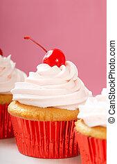 Vanilla cupcake with maraschino frosting and cherry