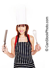 Smiling female chef with kitchen equipment on white...