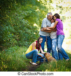 Family portrait - Family of four with a cute dog outdoors