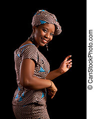 African dance - Young Ghanese african woman showing a dance...