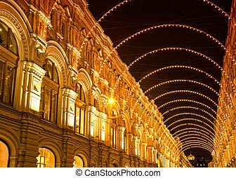 Holiday illumination in the form of an arch on an ancient building