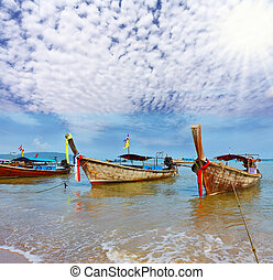 A boats Longtails anchored awaiting passengers - A gentle...