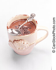 Hot chocolate on table - Hot chocolate in cup with spoon on...