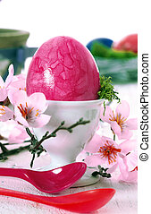 Pink Easter Still Life - Vibrant pink marbled Easteregg in...