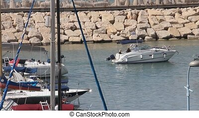Motor boat goes out from marina - Motor boat goes out to...