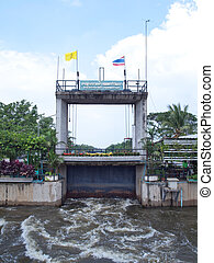 Thawi Watthana floodgate opening to relieve pressure from...