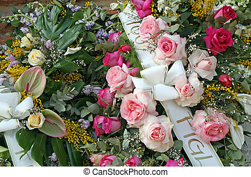 bouquets of flowers with roses and mimosas in memory of dead