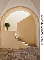 Santorini steps - A whitewashed staircase situated on the...