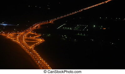Night view on roads from the height - from flying aircraft
