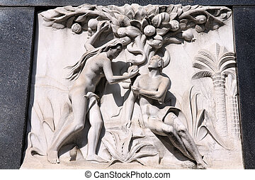 Adam and Eve - Milan, Italy. Old biblical scene sculpture at...
