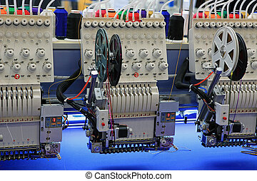 Industrial Embroidery Machine - special devices for a mass...