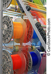 multi-colored yarns in the textile machine - yarn warping...