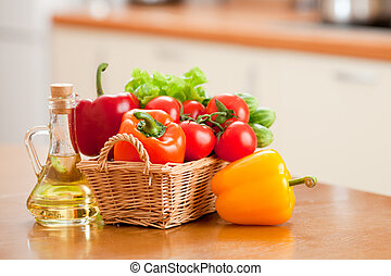 Healthy food fresh vegetables in basket and bottle with sunflowe
