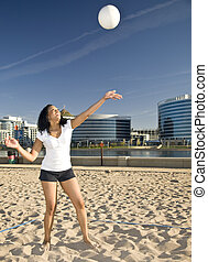 Playing volleyball - Attractive african-american model...