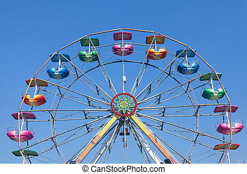 Ferris wheel - Brightly colored Ferris wheel against the...