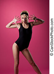 Beauty woman sport pin-up style on pink
