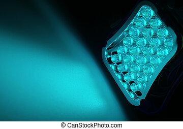 LEDs - 24 blue LEDs shine on a surface.