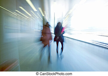 Business people walking - Intentional motion blurred image...