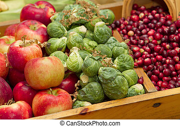 closeup group of fruit - many apples, berries and small...