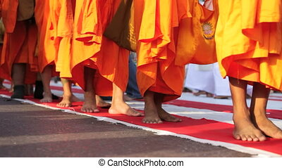 Mass Alms Giving in Bangkok - Monks are participating in a...