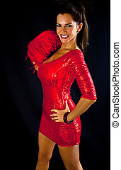 Sexy Brunette Woman in a Red Dress holding a feather.