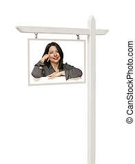 Real Estate Sign with Smiling Hispanic Woman