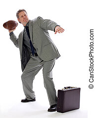 Business Man Throws a Football - A business man aims for...