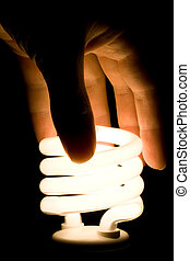 White Fluorescent Light Bulb - Hand screwing in energy...