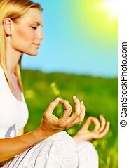 Yoga meditation outdoor, healthy female in peace, soul and...